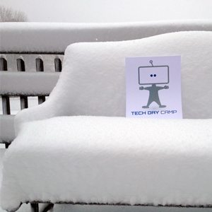 Techie on snow covered bench